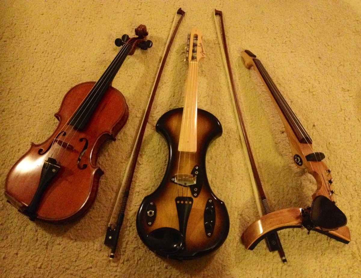 From left to right: Gand&Bernadel acoustic violin; 1958 Fender Electric Violin to custom build ART-VF4 violin