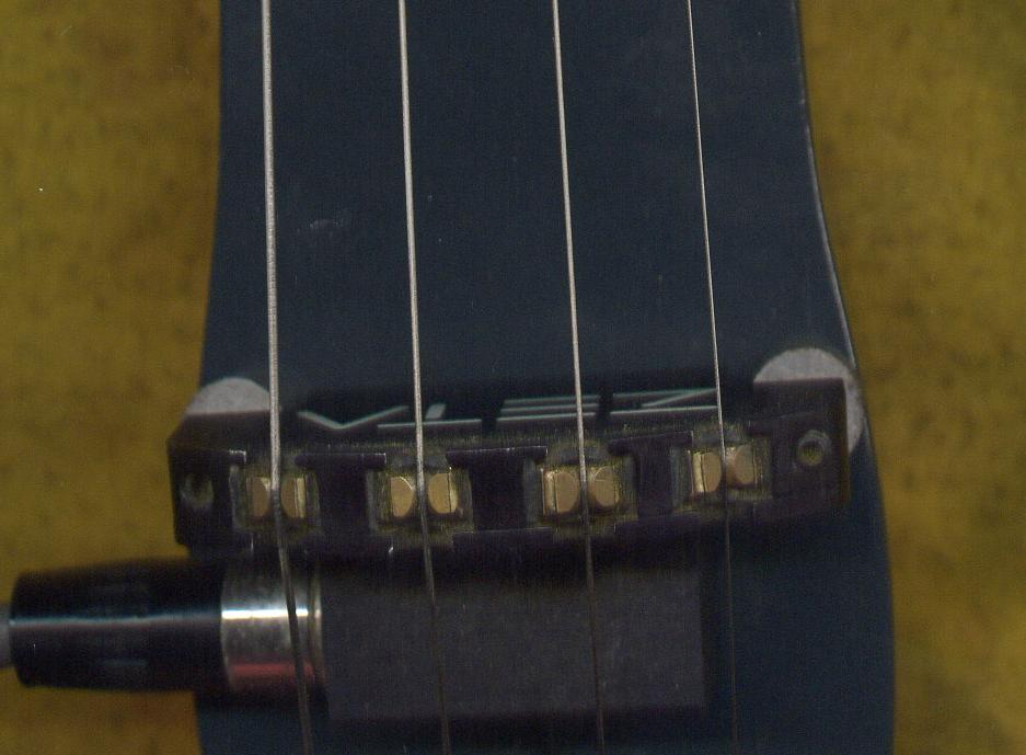 Close-up picture of a ZETA Jazz bridge on custom build Paul Cliff violin body